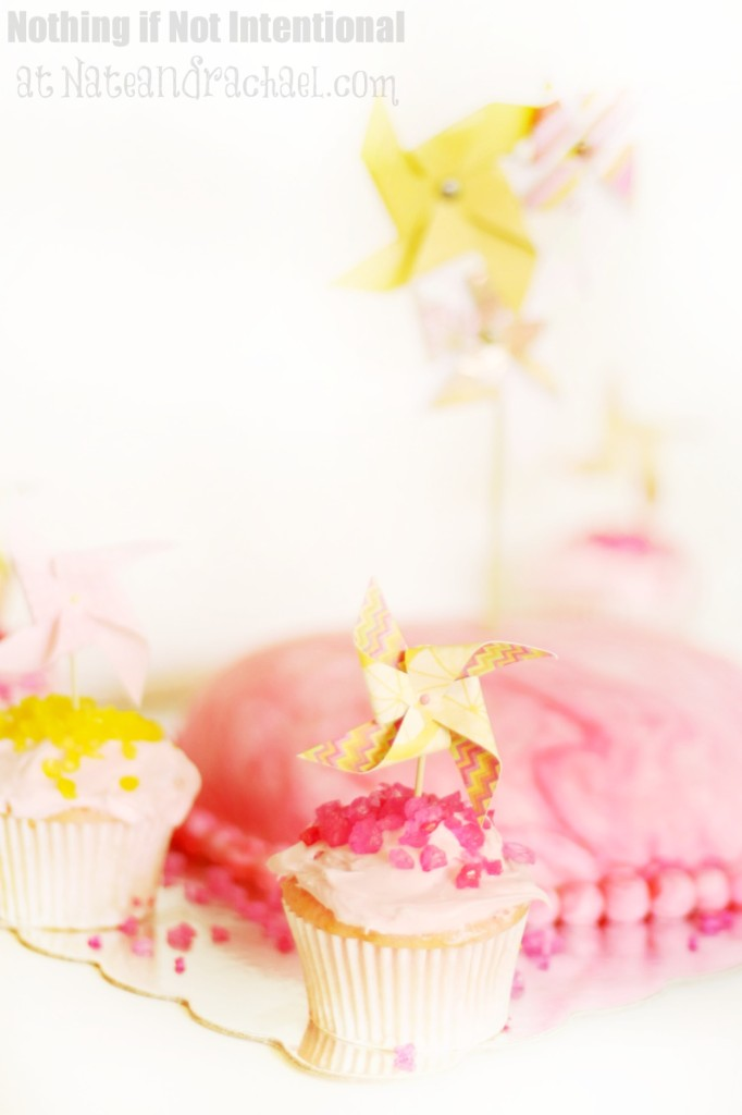 """Pink lemonade and pinwheels party—whimsical and sweet first birthday party. Highlights include rock candy and rock candy sprinkles, giant spinning pinwheels, the original """"favorite things"""" poster, favors that won't cause a sugar crash, group play ideas, and DIY invitations."""