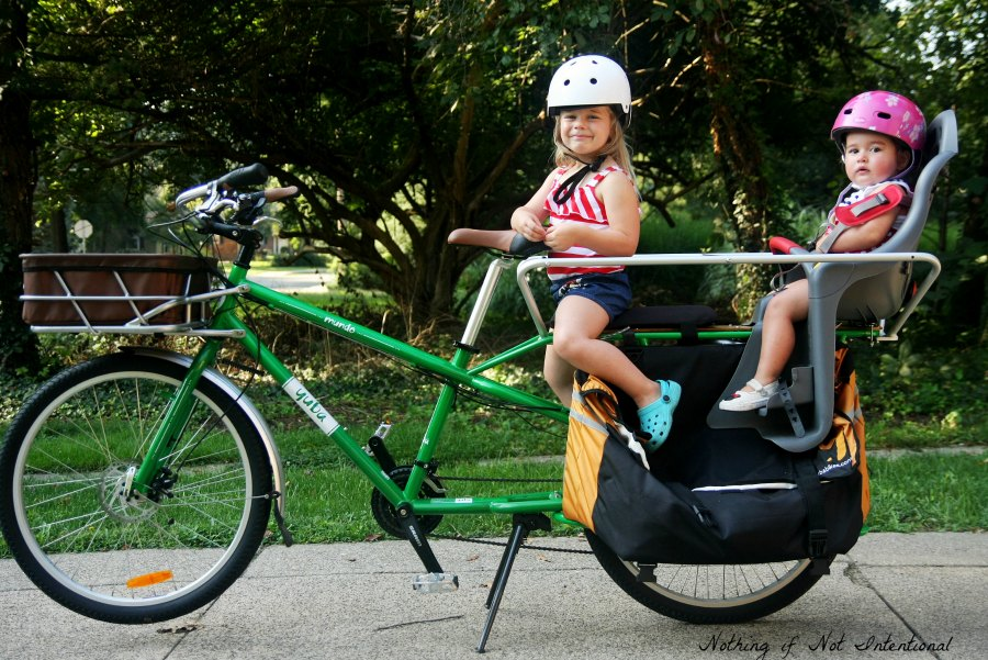 A Guide to Biking with Kids. The pros and cons of kids' bike gear options.